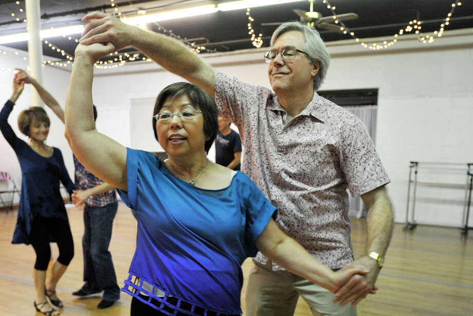 Doug Holaday and his wife, Mary Holaday, dance during the intermediate and advanced Hustle class at Dance Dimensions in Norwalk, Conn., on Tuesday, July 22, 2014. Photo: Jason Rearick / Stamford Advocate