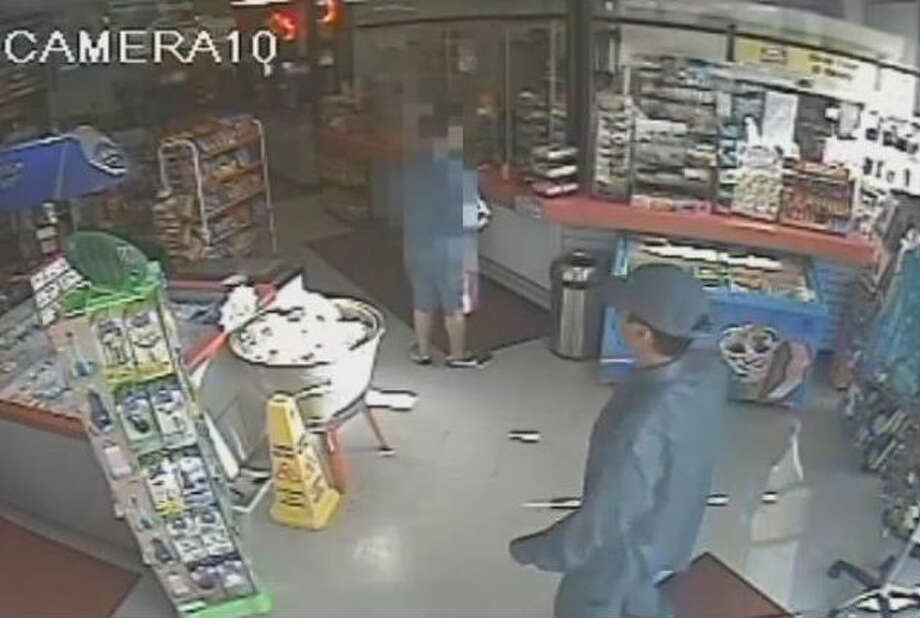 Screenshots from a July 11 armed robbery in Houston which didn't go as planned for the suspect. Photo: Houston Crime Stoppers