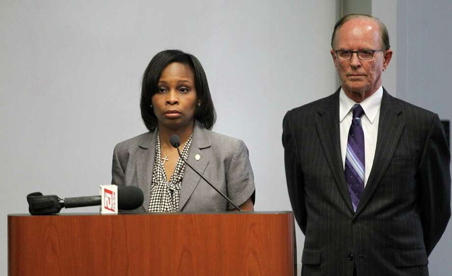 Bexar County Judge Nelson Wolff and Mayor Ivy Taylor discuss the decision to scrap the streetcar proposal during a news conference.  Photo: Timothy Tai / San Antonio Express-News / © 2014 San Antonio Express-News