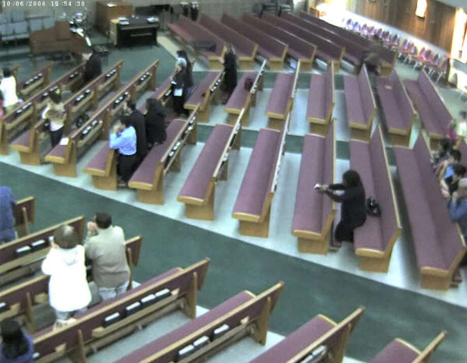 Moments later, the alleged suspect re-enters the church two aisles away from her original seat location. Photo: Harris County Sheriff's Office
