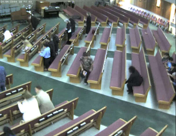 After a few minutes, the alleged suspect leaves her Pew. Photo: Harris County Sheriff's Office