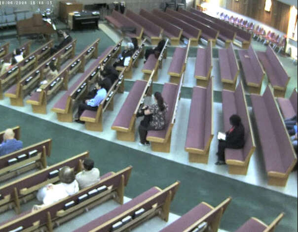 The alleged suspect takes a seat in a pew near the middle of the church. Photo: Harris County Sheriff's Office