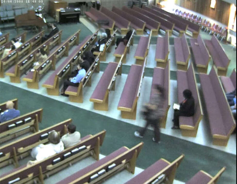 The alleged suspect enters the church late. Photo: Harris County Sheriff's Office