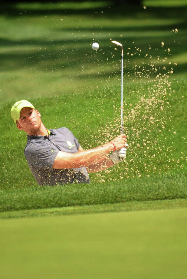 John Jackopsic, of the Gilette Ridge Golf Course in Bloomfield, hits from a sand trap at the 15th hole at the 80th Connecticut Open Championship golf tournament in Wilton, Conn. on Wednesday, July 30, 2014. Photo: Brian A. Pounds / Connecticut Post
