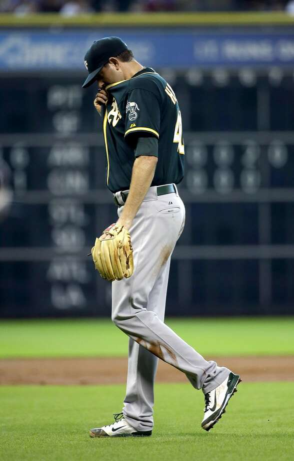 A's starter Jason Hammel leaves the field after giving up six runs in the first inning. He's 0-4 since the A's traded for him. Photo: David J. Phillip, Associated Press