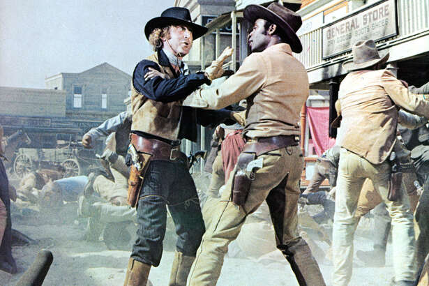 Gene Wilder gets into an altercation with Cleavon Little in a scene from the film 'Blazing Saddles', 1974.