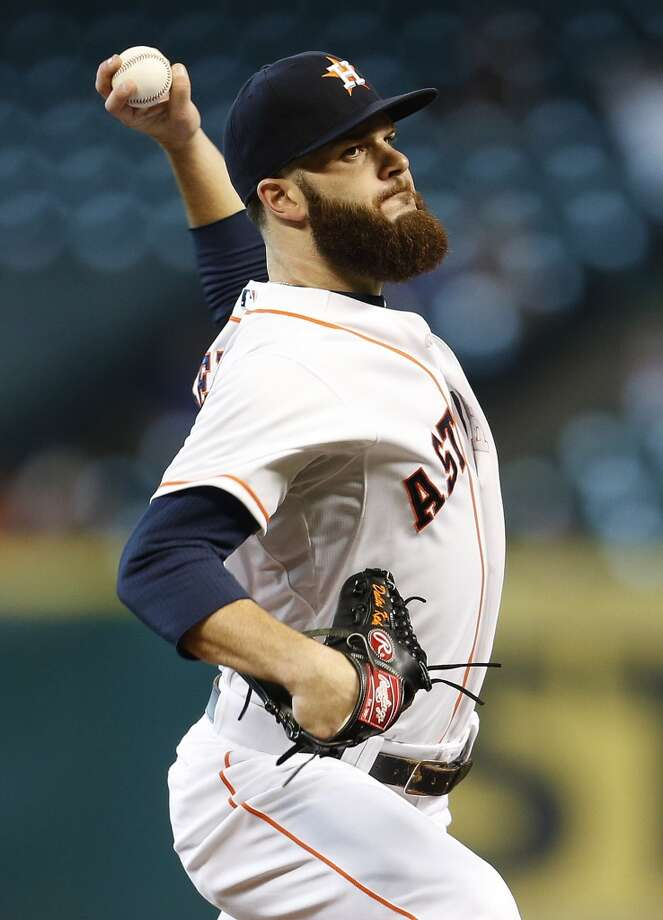July 30: Astros 8, Athletics 1  Astros starting pitcher Dallas Keuchel (60) pitches during the first inning. Photo: Karen Warren, Houston Chronicle