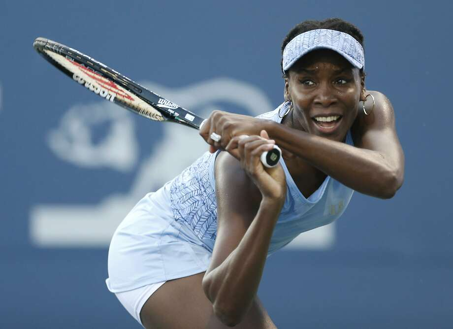 Venus Williams has a disease that causes fatigue and joint pain, but she's still having fun. Photo: Beck Diefenbach, Associated Press