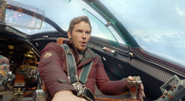 """""""Guardians Of The Galaxy""""IMDb: 9/10Rotten Tomatoes: 91 percentReview by Michael Ordoña: Role makes Pratt new kind of heroAs a boy, Quill is abducted from Earth just after his mother dies; he is raised by space pirates before striking out on his own and discovering a plot between super-beings Ronan and Thanos (remember the first post-credits scene of """"Avengers""""?) to destroy an entire planet and its billions of inhabitants. Along the way, he meets fellow outsiders Gamora, a beautiful, green-skinned assassin (Zoe Saldaña); revenge-driven, hyper-literal brute Drax the Destroyer (former World Wrestling Entertainment champ David Bautista); genetically and cybernetically modified Rocket Raccoon (voiced by Bradley Cooper); and Groot (voiced by Vin Diesel), a tree of few words. Photo: HOEP / Disney - Marvel"""
