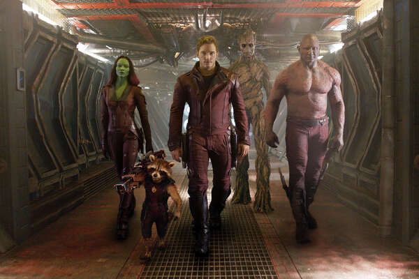 """This image released by Disney - Marvel shows, from left, Zoe Saldana, the character Rocket Racoon, voiced by Bladley Cooper, Chris Pratt, the character Groot, voiced by Vin Diesel and Dave Bautista in a scene from """"Guardians Of The Galaxy."""" (AP Photo/Disney - Marvel)"""