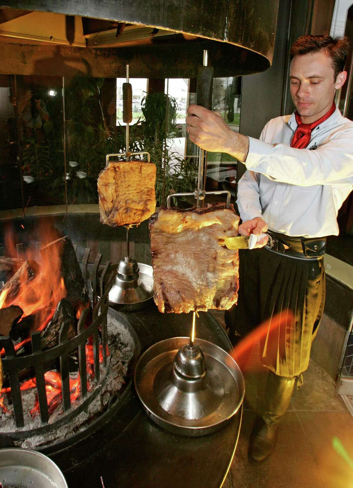 At Fogo de Chao, gauchos serve a selection of flame-roasted beef ribs and other meats. One diner said she observed one of four girls running around the restaurant nearly collide with a server.