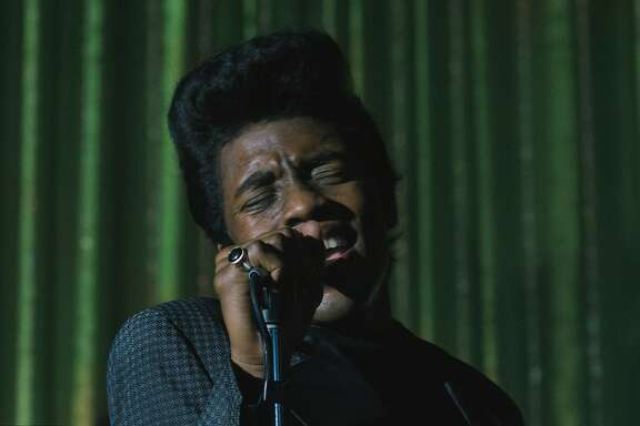 "CHADWICK BOSEMAN as James Brown in ""Get on Up"". Based on the incredible life story of the Godfather of Soul, the film will give a fearless look inside the music, moves and moods of Brown, taking audiences on the journey from his impoverished childhood to his evolution into one of the most influential figures of the 20th century."