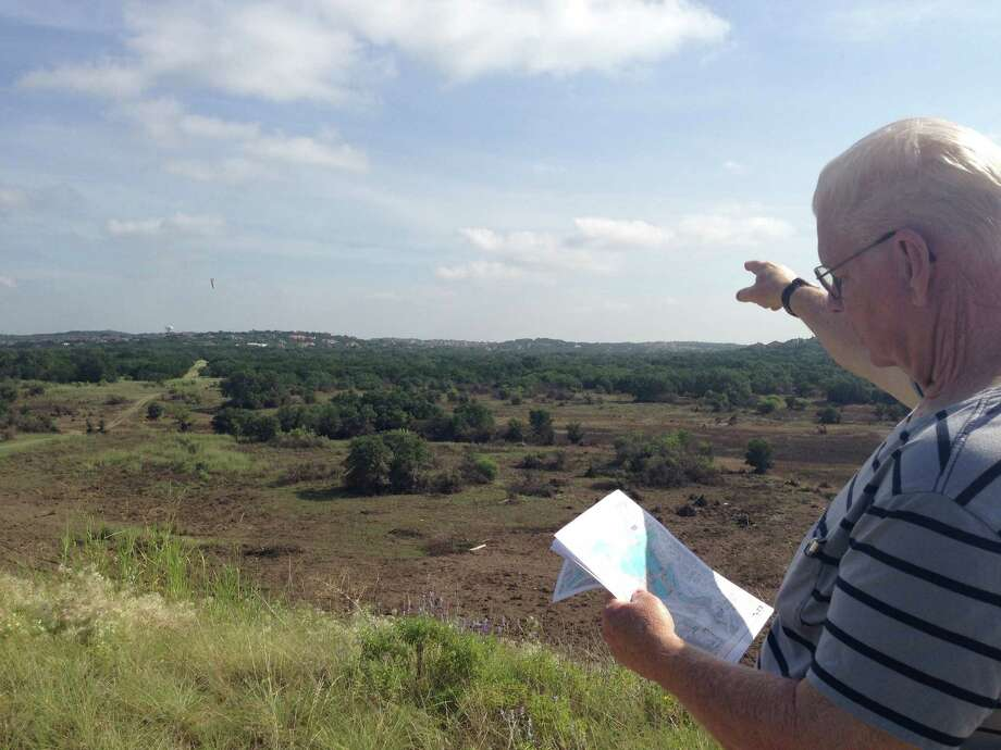 David Walsworth, chairman of the Wilderness Oak Alliance Panther Springs Park Committee and former president of the Wilderness Oak Alliance, looks over a site map and points out the place of the future trails.Click through the slideshow to get a glimpse of the area. Photo: Rebecca Salinas/mySA.com