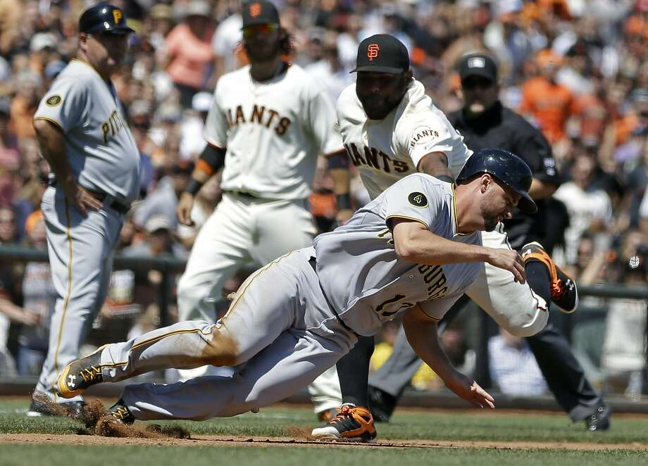 Gaby Sanchez is tagged out by Pablo Sandoval to end a bizarre double play that began with the Giants issuing a walk. Photo: Ben Margot, Associated Press