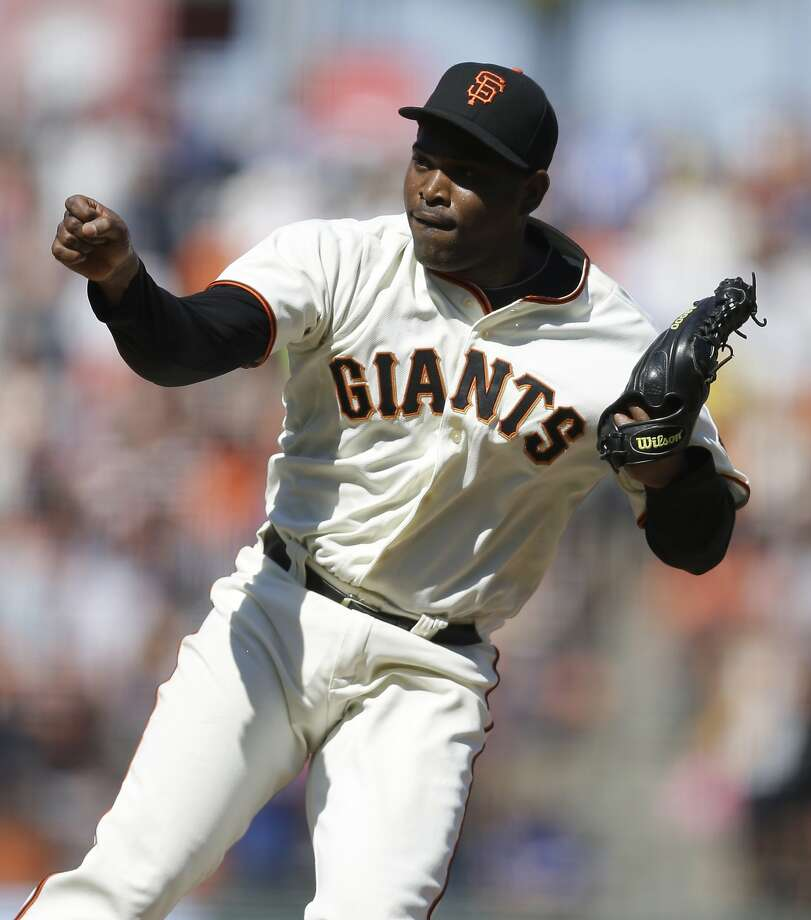 San Francisco Giants' Santiago Casilla celebrates the 7-5 defeat of the Pittsburgh Pirates at the end of a baseball game Wednesday, July 30, 2014, in San Francisco. (AP Photo/Ben Margot) Photo: Ben Margot, Associated Press