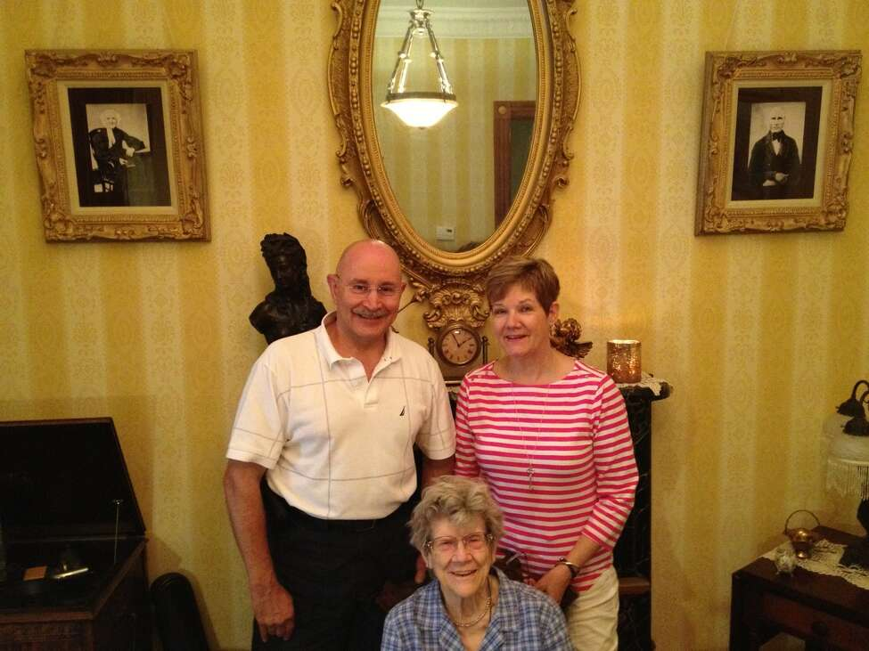 Tony and Bonnie Mariano pose with 90-year-old Martha Slingerland, archivist of the old Dutch family she married into. She was given a tour of the Mariano's Lancaster Street townhouse that Hester Slingerland Winne built in 1895. The Marianos have meticulously restored the Victorian house and researched its history, with the help of Slingerland. (Paul Grondahl / Times Union)