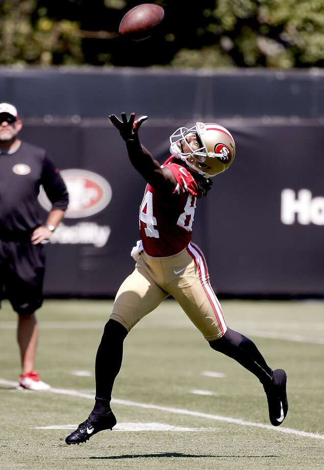 Receiver Brandon Lloyd, (84) reaches out for a pass during drills, as the San Francisco 49ers hold training camp to prepare for the 2014 season in Santa Clara, Calif.,  on Thursday July 24, 2014. Photo: Michael Macor, The Chronicle