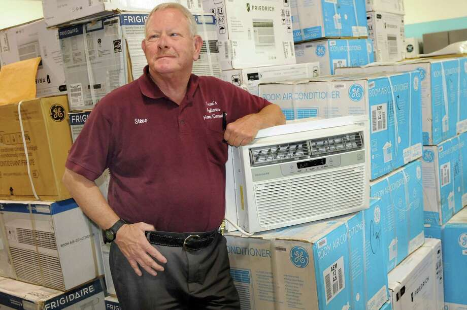Cocca's Appliances general manager Steve Baker with air conditioner units for sale on Wednesday, July 30, 2014, at Cocca's Appliances in Colonie, N.Y. (Cindy Schultz / Times Union) Photo: Cindy Schultz / 00028002A