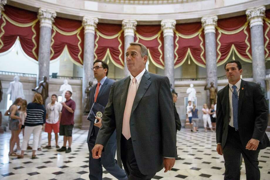 House Speaker John Boehner of Ohio strides to the House chamber  on Capitol Hill in Washington, Wednesday, July 30, 2014, as lawmakers prepare to move on legislation authorizing an election-year lawsuit against President Barack Obama that accuses him of exceeding his powers in enforcing his health care law. Democrats have branded the effort a political charade aimed at stirring up Republican voters for the fall congressional elections. They say it's also an effort by top Republicans to mollify conservatives who want Obama to be impeached — something Boehner said Tuesday he has no plans to do.  (AP Photo/J. Scott Applewhite) Photo: J. Scott Applewhite, STF / AP