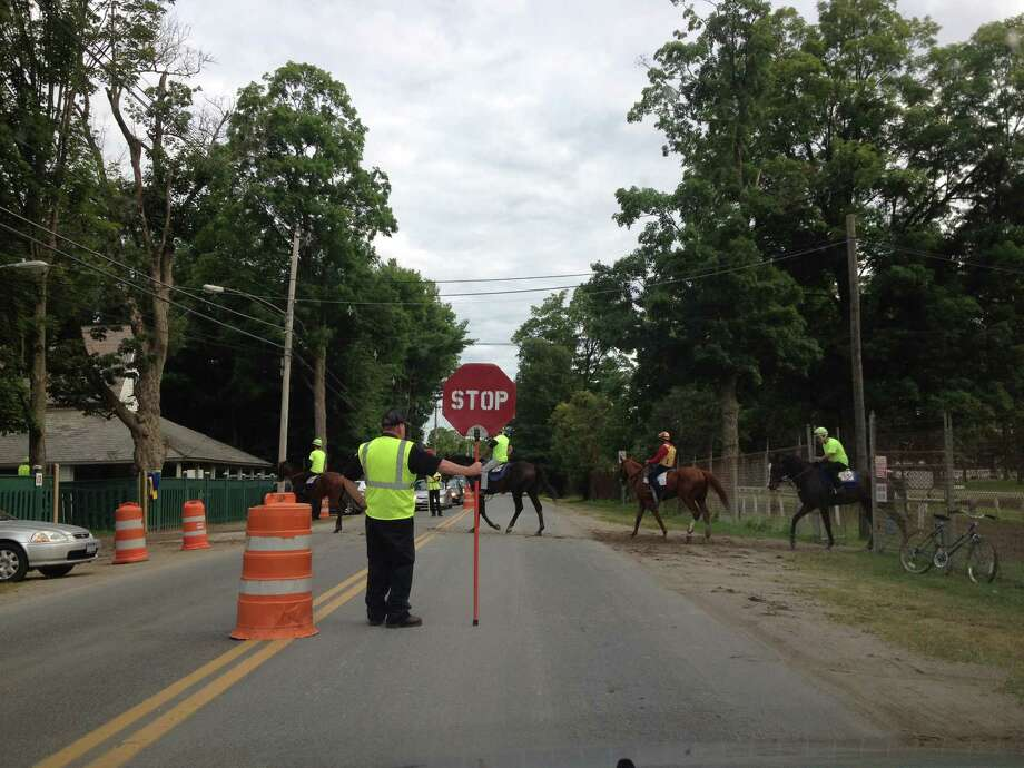 Maybe you have run into the equine road block on Nelson Avenue or the one on Union Avenue during the summer months in the Spa City. If you are forced to stop on of these roads, it's because during the 40-day Saratoga race meet, horses always have the right of way. This was the scene early Wednesday morning as some of the four-legged critters crossed Nelson Avenue on the way back to their stalls after morning exercise. ( Tim Wilkin / Times Union )
