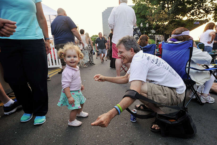 Zora Chara Zaranšek DeVos, left, dances with her uncle, Dan DeVos, during Jazz Up July in Columbus Park in Stamford, Conn., on Wednesday, July 30, 2014. Hearst Connecticut Media Group is a sponsor of the event. Photo: Jason Rearick / Stamford Advocate