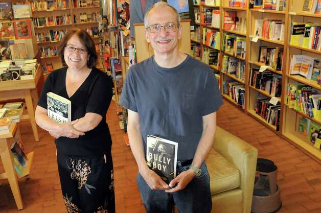 Steve Kozlowski, volunteer coordinator for the AIDS Council of Northeastern New York, center, and Michele McClave, the council's executive director, on Tuesday, July 29, 2014, at the Book House in Albany, N.Y. They will hold a sidewalk book sale Saturday from 9 a.m. to 6 p.m. to benefit the not for profit. (Cindy Schultz / Times Union) Photo: Cindy Schultz / 00027945A