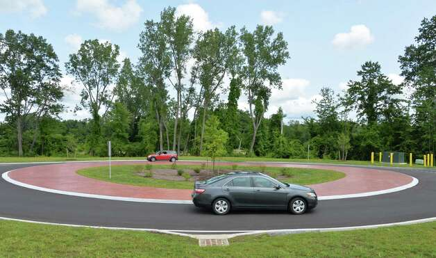 New roundabout, looking north, on Marcus Blvd. Tuesday July 29, 2014, in Colonie, NY.  (John Carl D'Annibale / Times Union) Photo: John Carl D'Annibale / 00027979A