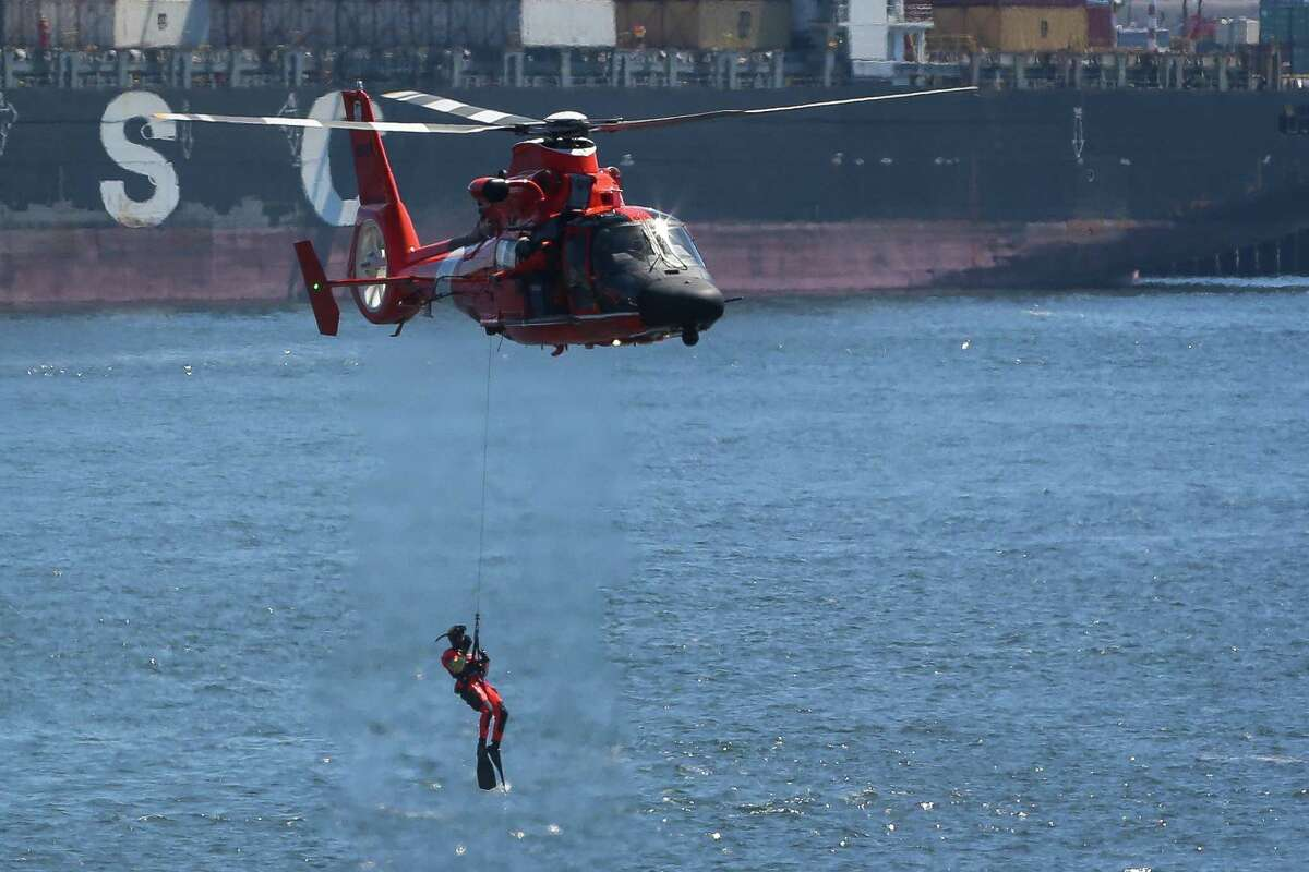 The Coast Guard performs a rescue drill for spectators during the Seafair Parade of Ships & Flight. Hundreds of spectators lined up along Elliott Bay to watch the incoming ships and military flyovers on July 30, 2014.
