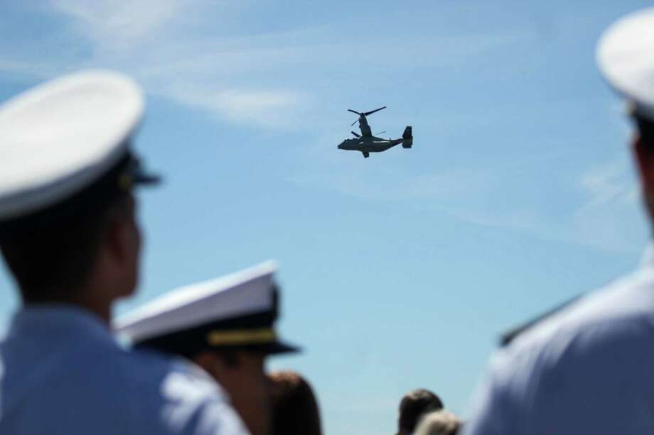 A Bell Boeing V-22 Osprey performs a flyover during the Seafair Parade of Ships & Flight. Hundreds of spectators lined up along Elliott Bay to watch the incoming ships and military flyovers on July 30, 2014. Photo: JOSHUA BESSEX, SEATTLEPI.COM / SEATTLEPI.COM