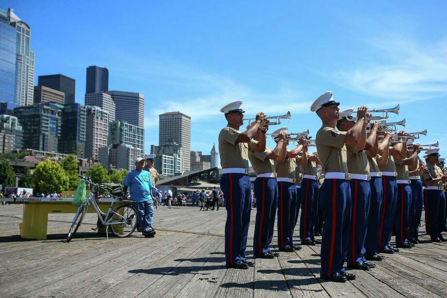 The Marine Band performs during the Seafair Parade of Ships & Flight. Hundreds of spectators lined up along Elliott Bay to watch the incoming ships and military flyovers on July 30, 2014. Photo: JOSHUA BESSEX, SEATTLEPI.COM / SEATTLEPI.COM