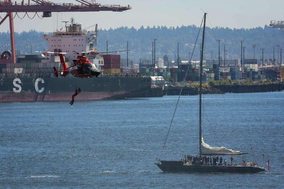 The Coast Guard performs a rescue drill for spectators during the Seafair Parade of Ships & Flight. Hundreds of spectators lined up along Elliott Bay to watch the incoming ships and military flyovers on July 30, 2014. Photo: JOSHUA BESSEX, SEATTLEPI.COM / SEATTLEPI.COM