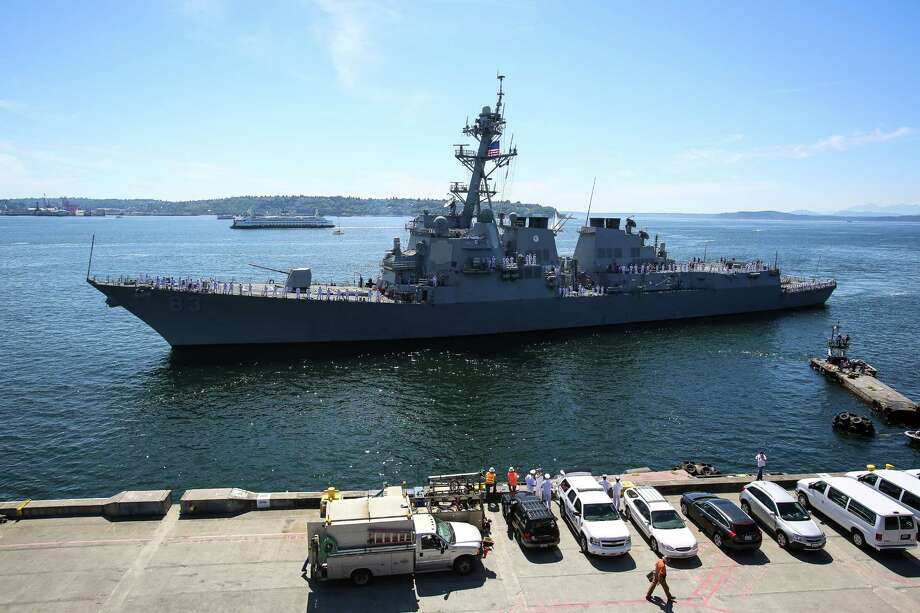 The USS Howard prepares to dock following the Seafair Parade of Ships & Flight. Hundreds of spectators lined up along Elliott Bay to watch the incoming ships and military flyovers on July 30, 2014. Photo: JOSHUA BESSEX, SEATTLEPI.COM / SEATTLEPI.COM