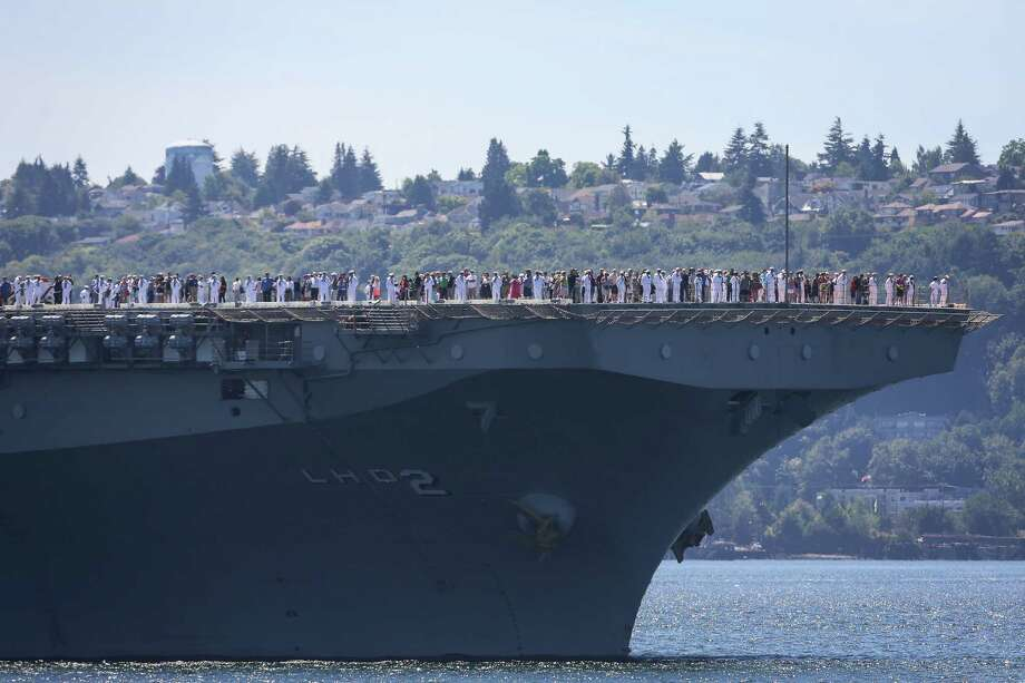 Crew and family of the USS Essex stand on the deck during the Seafair Parade of Ships & Flight. Hundreds of spectators lined up along Elliott Bay to watch the incoming ships and military flyovers on July 30, 2014. Photo: JOSHUA BESSEX, SEATTLEPI.COM / SEATTLEPI.COM
