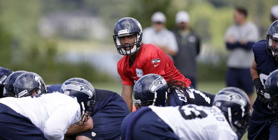 Wilson surveys the defense at Seahawks training camp on Friday, July 25, 2014. Photo: Associated Press