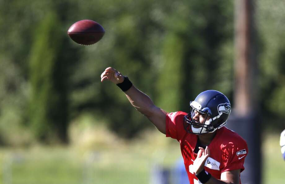Wilson lets a pass rip at Seahawks training camp on Sunday, July 27, 2014. Photo: Elaine Thompson, Associated Press