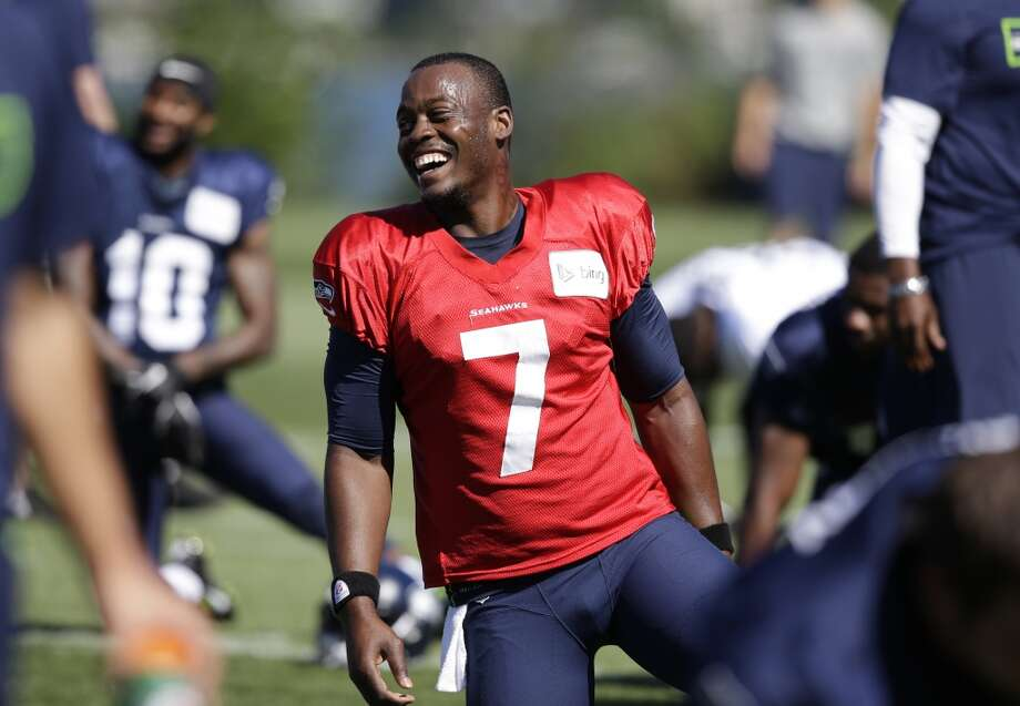 Quarterback Tarvaris Jackson smiles while stretching at Seahawks training camp on Sunday, July 27, 2014. Photo: Elaine Thompson, Associated Press