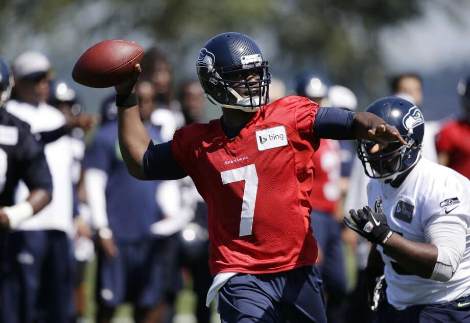 Jackson lets go of a pass at Seahawks training camp on Saturday, July 26, 2014. Photo: Elaine Thompson, Associated Press