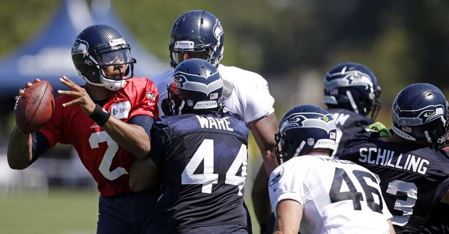 Pryor (2) is hurried as he drops back to pass at Seahawks training camp on Saturday, July 26, 2014. Photo: Elaine Thompson, Associated Press