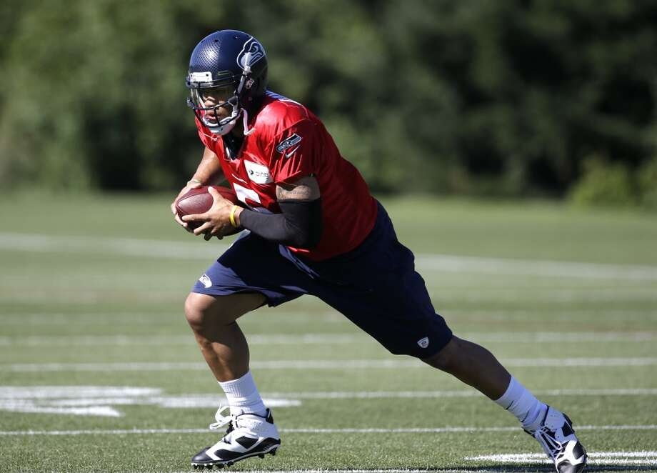 Daniels runs at Seahawks training camp on Tuesday, July 29, 2014. Photo: Elaine Thompson, Associated Press