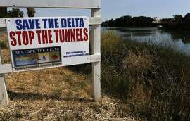 """Signs along River road on the Delta waters of the Sacramento River, Calif., as seen on Wednesday July 30, 2014., near Rio Vista, Calif. The Bay Institute, a well-regarded environmental group, has determined the the Bay Delta Conservation Plan to construct tunnels to send water south would cause two salmon species to die out and would """"devastate San Francisco Estuary, Central Valley Rivers and water quality."""