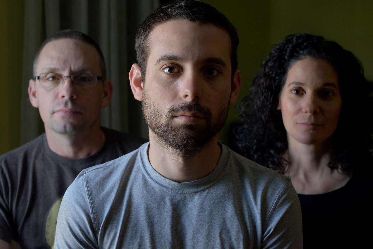 Adam Winfield, center, with parents Chris (left) and Emma (right). Scene from the war documentary, The Kill Team.