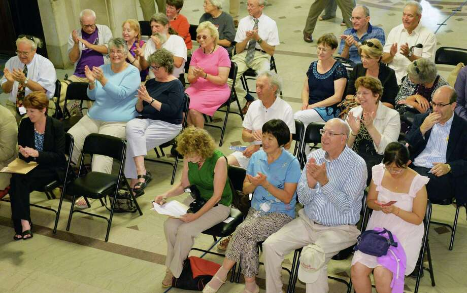 A small audience applauds during a celebration of Medicare's 49th birthday at Albany City Hall Wednesday, July 30, 2014, in Albany, N.Y.  (John Carl D'Annibale / Times Union) Photo: John Carl D'Annibale / 00027910A