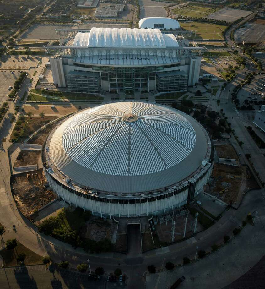 If preservationists are triumphant, the Reliant Astrodome - seen here with the Reliant Stadium - will be around for future Houstonians to enjoy. Photo: Smiley N. Pool, Staff / © 2014  Houston Chronicle
