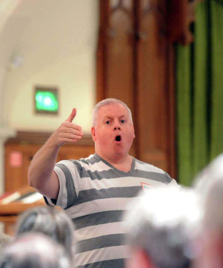 "Dr. Craig Scott Symons, director of music at First Congregational Church in Old Greenwich, leads the ""Summer Sings"" session at the church in the Old Greenwich section of Greenwich, Conn., Wednesday night, July 30, 2014. Photo: Bob Luckey / Greenwich Time"