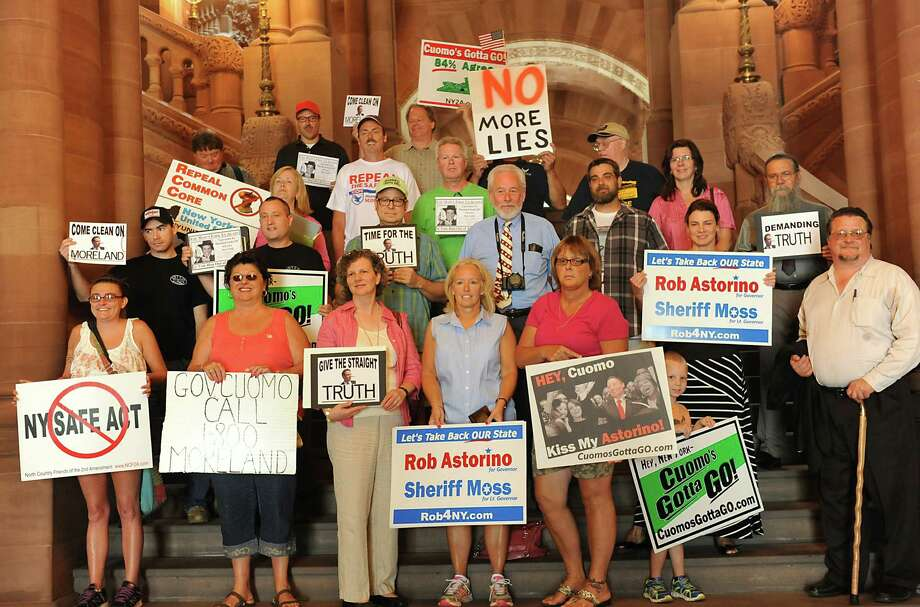 Safe Act opponents conduct a walking tour of the Capitol to demand answers to questions about Gov. Andrew Cuomo's handling of the Moreland Commission on Wednesday, July 30, 2014 in Albany, N.Y.  (Lori Van Buren / Times Union) Photo: Lori Van Buren / 00027996A