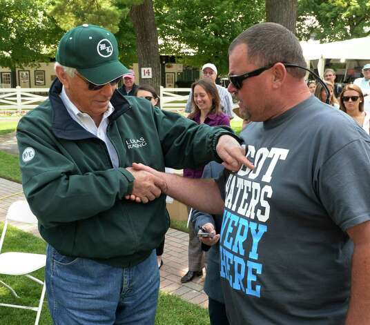 Trainers Wayne Lukas, left and Eric Guillot share a humorous moment at the post position draw for Saturday's Whitney Stakes Wednesday morning at the Saratoga Race Course July 30, 2014 in Saratoga Springs, N.Y.  (Skip Dickstein / Times Union) Photo: SKIP DICKSTEIN