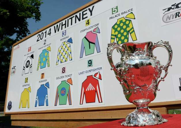 The Whitney winner's trophy sits near the board that shows the post positions and the entrants names for Saturday's Whitney Stakes Wednesday morning July 30, 2014 at the Saratoga Race Course  in Saratoga Springs, N.Y.  (Skip Dickstein / Times Union) Photo: SKIP DICKSTEIN