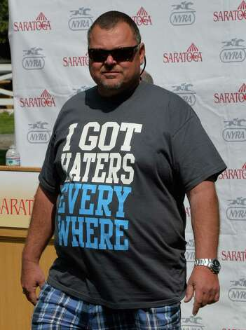 Trainer Eric Guillot wears his feeling on his t-shirt during the post position draw for the Saturday's Whitney Stakes Wednesday afternoon July 30, 2014 at the Saratoga Race Course  in Saratoga Springs, N.Y.  (Skip Dickstein / Times Union) Photo: SKIP DICKSTEIN
