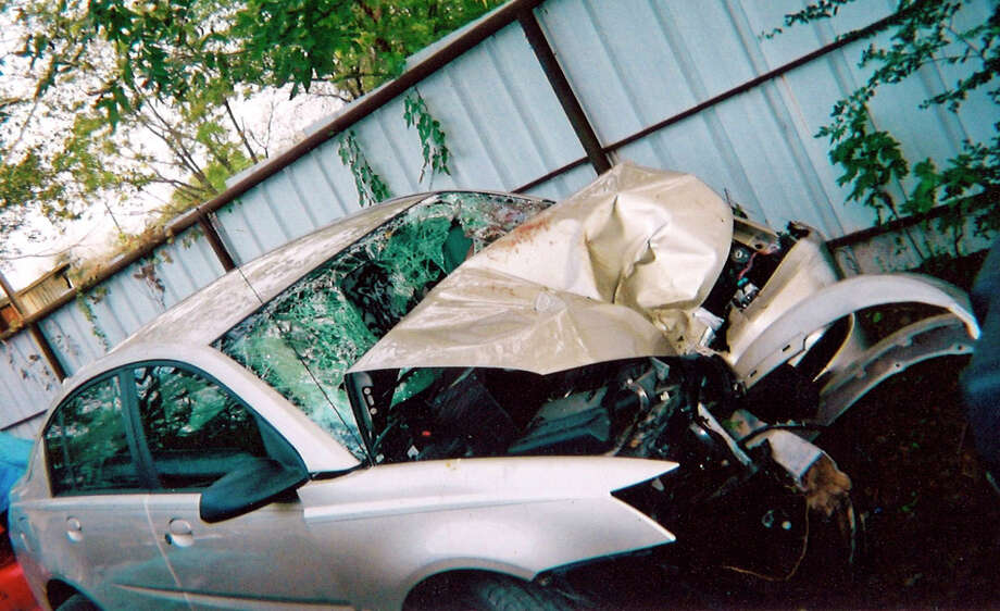 This undated photo provided by attorney Robert Hilliard shows the wreckage of the car crash that killed Gene Mikale Erikson. A former Texas district attorney has asked a state agency to pardon Candice Anderson who pleaded guilty in the 2004 crash that killed her fiance, Erikson, but which her attorney says was caused by a faulty General Motors ignition switch. Anderson's attorney Robert Hilliard, said the National Highway Traffic Safety Administration in May confirmed to Erickson's mother the crash was caused by the bad switch.  (AP Photo/Robert Hilliard) Photo: HONS / Robert HIlliard