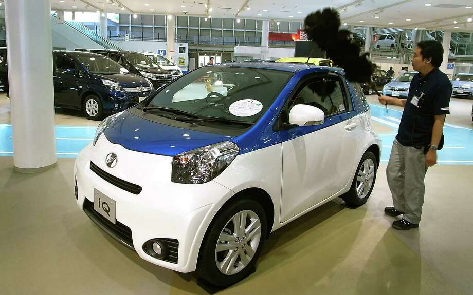 Products such as the IQ compact car have kept  Toyota the world's top auto seller. Photo: Eugene Hoshiko, STF / AP